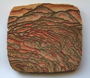 versteend woestijnzand rode, gele en groene kleur door ijzer